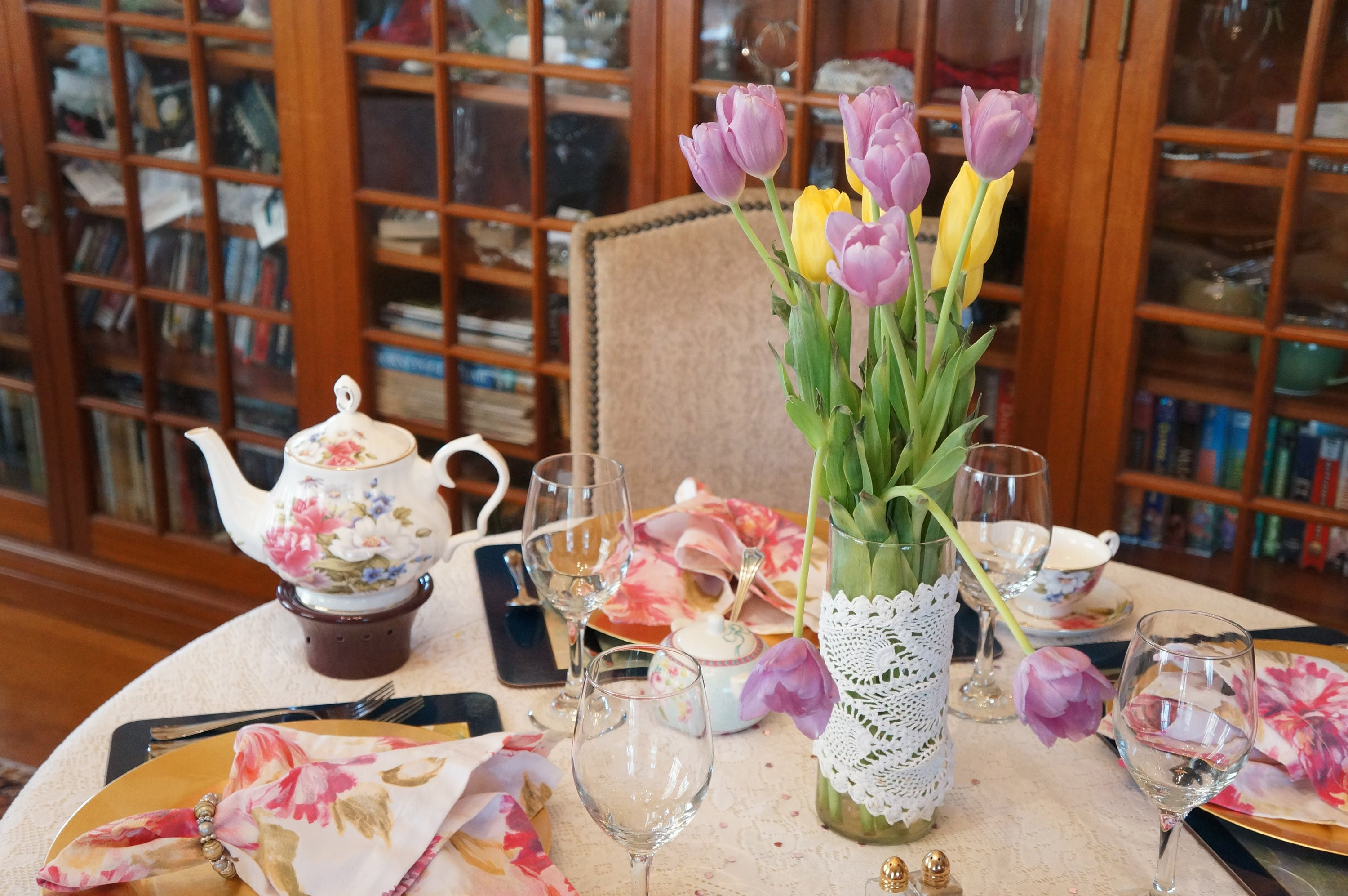 Here is a shot of a table in our tea parlor, a part of our seacoast Nh hotel. The image displays a beautiful flower centepiece, tea pot, and place settings ready for hapy guests.