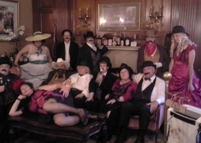 Here is a picture of one of the events held at our hotel seacoast nh. This picture shows guests dressed in old western garb sitting on our aged red victorian couch.