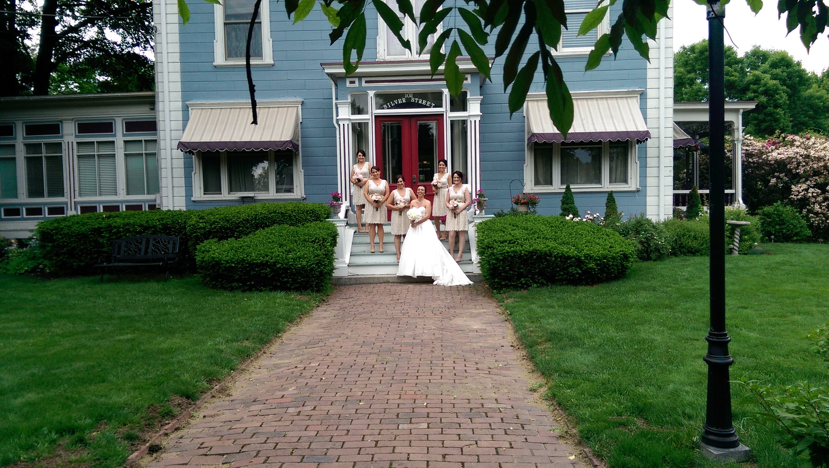 Here is an image of a brida party posing on the front steps of our hotel dover nh.