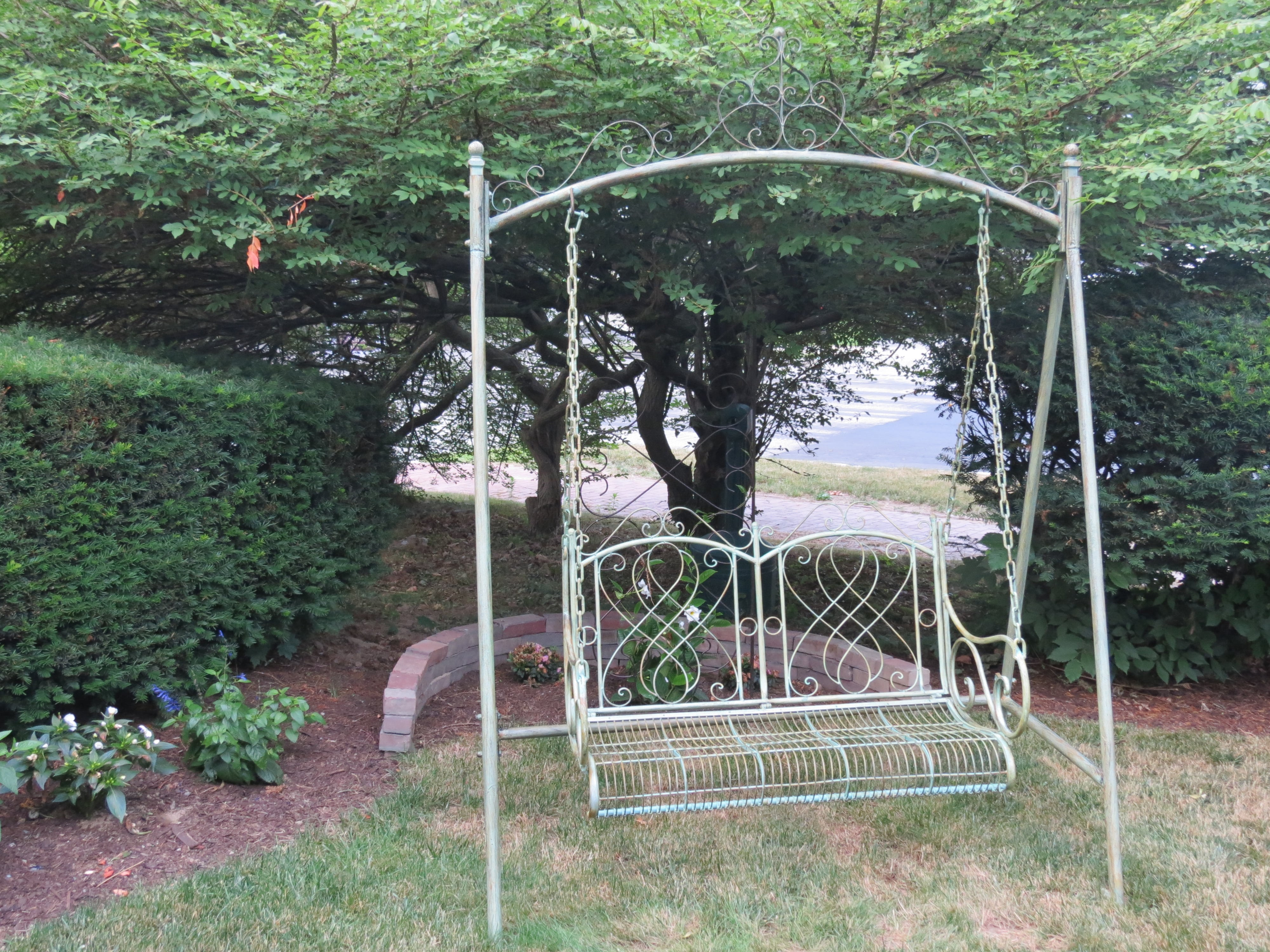 Picture of our beautiful swing outside our Hotel in Dover NH, right in front of the garden.