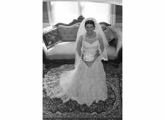 Here is a beautiful bride posing in one of our sitting areas. The bride standing in front of a well aged victorian couch. Our dover NH hotel hosts intimate wedding parties