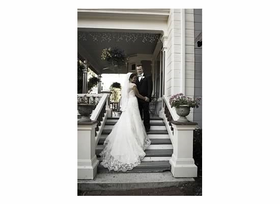 Here is a happy couple on the stairs of our beautiful covered porch. We are your destination wedding venue at our seacoast nh hotel.