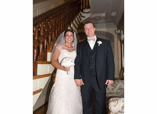 Here is a happy newly wedded couple posing at the bannister on the first floor of our hotel near seacoast nh.