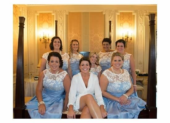Here is a bridal party preparing for the big day. We host many intimate wedding events at our hotel durham nh. This shows the bride in the middle of 7 bridesmaids.