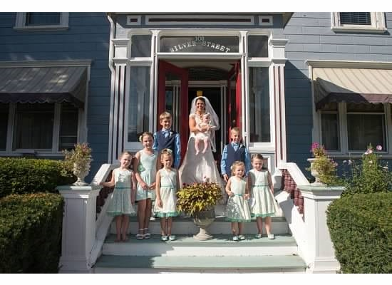 Here is a picture of a bridal party that chose our beautiful durham nh area hotel. This shows the bride holding an infant.