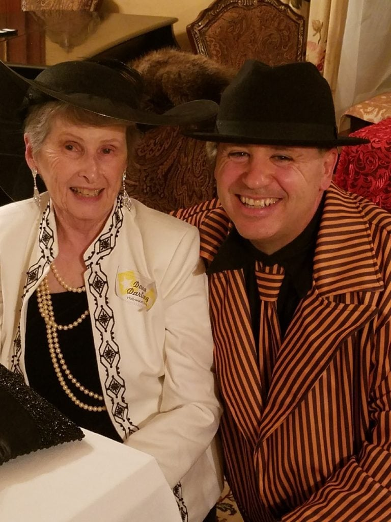 Two people having a wonderful time participating in our murder mystery at our Dover NH area hotels