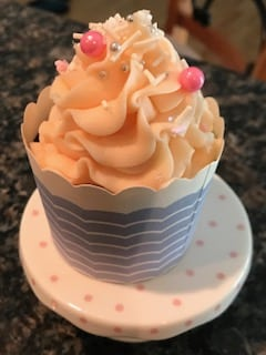 Here is a single cupcake on a polka dotted plate. This is one of Gail's creations at our Durham NH Hotel.