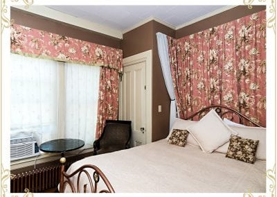 Check out the Henrietta, a room at our Dover NH hotel. This image shows the bed with flowered tapestries.