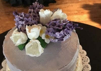 A stunning purple lilac wedding cake